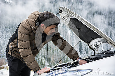 man inspecting car engine stock photo image 67562618. Black Bedroom Furniture Sets. Home Design Ideas