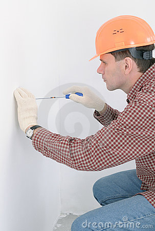 Man installing electrical box