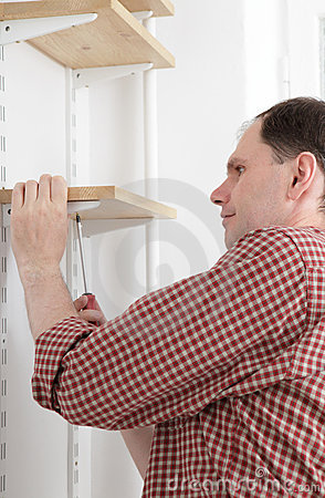 Man installing shelves