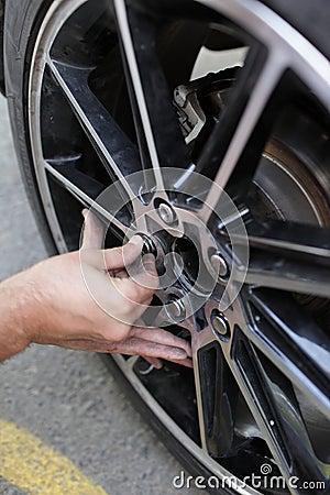Man installs spare wheel