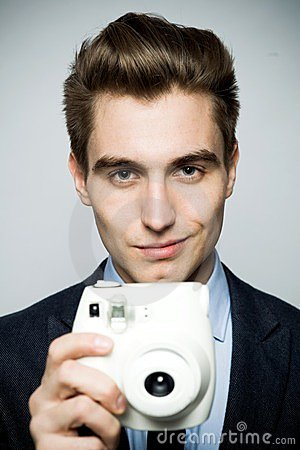 Man with instant camera