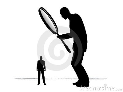 Man Investigating With Magnifying Glass