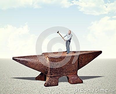 Man on iron anvil