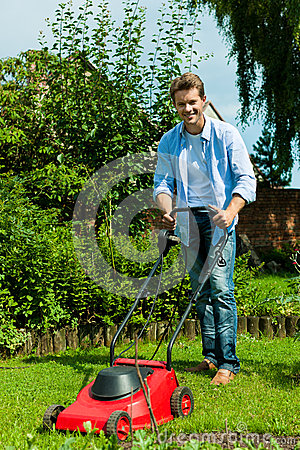 Free Man Is Mowing The Lawn In Summer Royalty Free Stock Photos - 36007858
