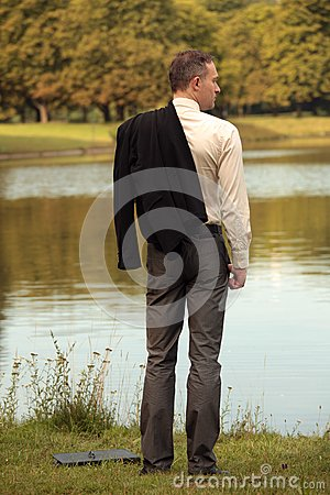 Man with jacket at the shore