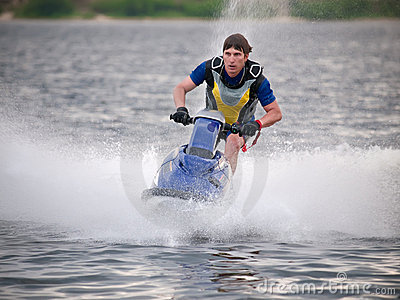 Man on jet ski rides fast