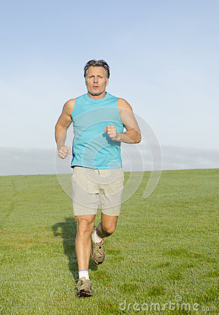 Man jogging in blue shirt