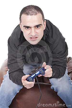 Man with a joystick for game console Stock Photo
