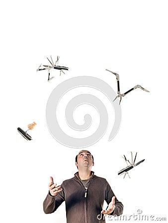 Man juggling tools