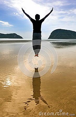 Man jump on beach