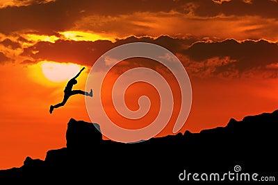 Man jump through the rock
