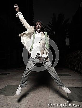 Man jumping and grabbing his crotch