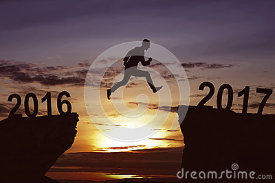 Man jumping on the hill toward 2017