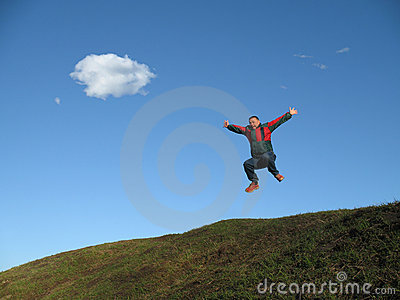 Man jumping on hillside