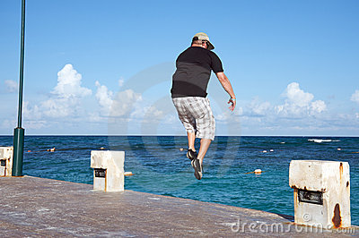 Man jumping into the ocean