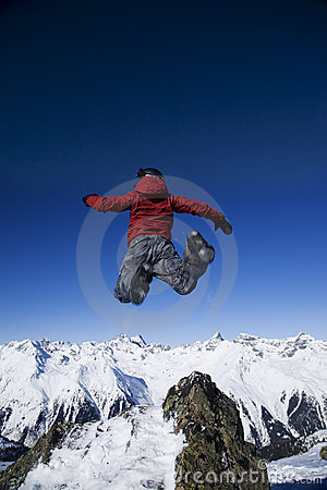 Free Man Jumping Over The Mountains Stock Photos - 7801473