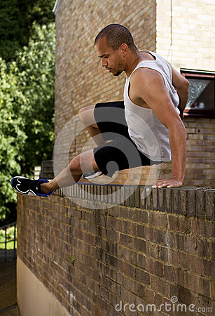 Man jumping a wall