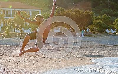 Man jumps on a beach