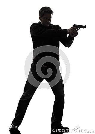 Man killer policeman aiming  gun standing silhouette