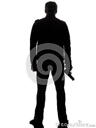 Free Man Killer Policeman Holding Gun Walking Silhouette Stock Photos - 30553123