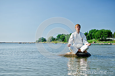 Man in kimono meditating