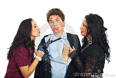 Man kissed by two elegant women