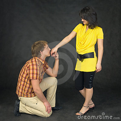 Man kisses a hand to the woman