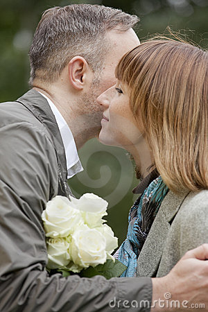 Man kisses woman by dating
