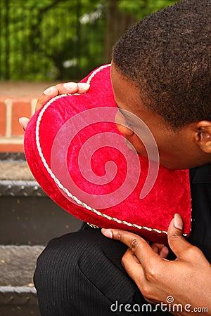 Man kissing a heart