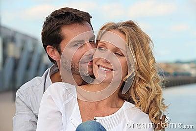 Man kissing his partner