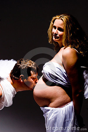 Man kissing pregnant belly