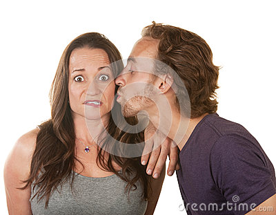 Man Kissing Surprised Woman