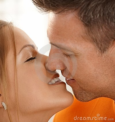 Man kissing woman