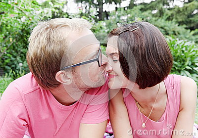 Man Kissing Woman on the Nose