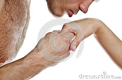 Man kissing woman s hand.