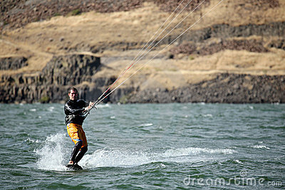 Man kite surfing on river Editorial Image
