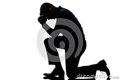 Man kneeling sadness praying full length