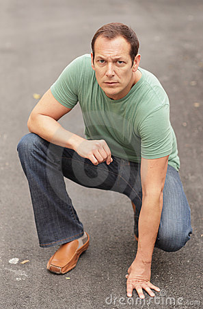 Man kneeling in the street