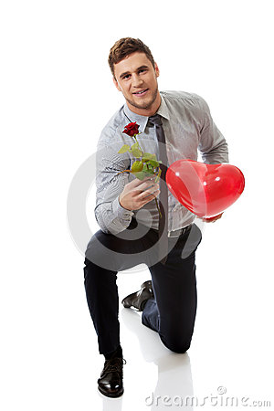 Free Man Kneeling With Red Rose And Heart Balloon. Royalty Free Stock Photos - 60706138