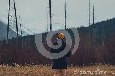 Man In Knitted Cap And Black Coat Fronting Forest Trees And Mountain During Daytime Free Public Domain Cc0 Image