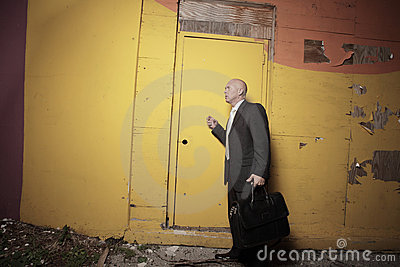 Man knocking on a yellow door