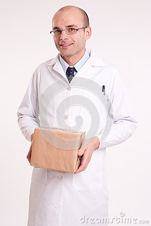 Man in lab coat holding a box