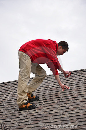 Man on Ladder on a roof