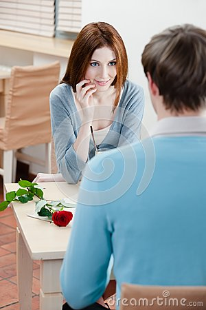 Man and lady are at the table