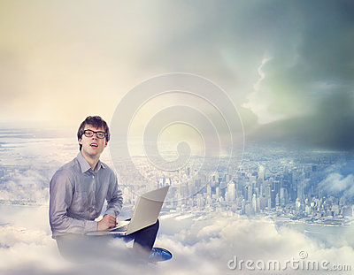 Man with Laptop on Clouds