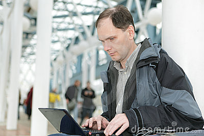 Man with laptop indoors