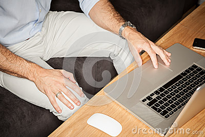 Man with laptop in office