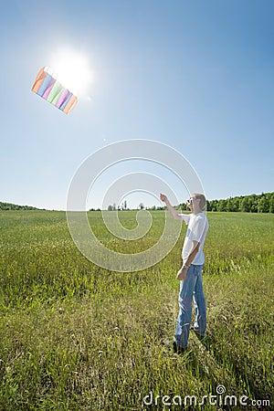 Man launch kite in field