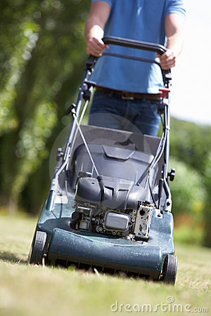 Man with lawnmower