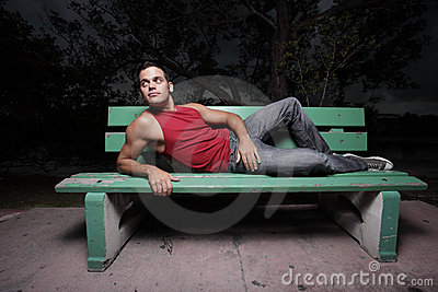 Man laying on a bench